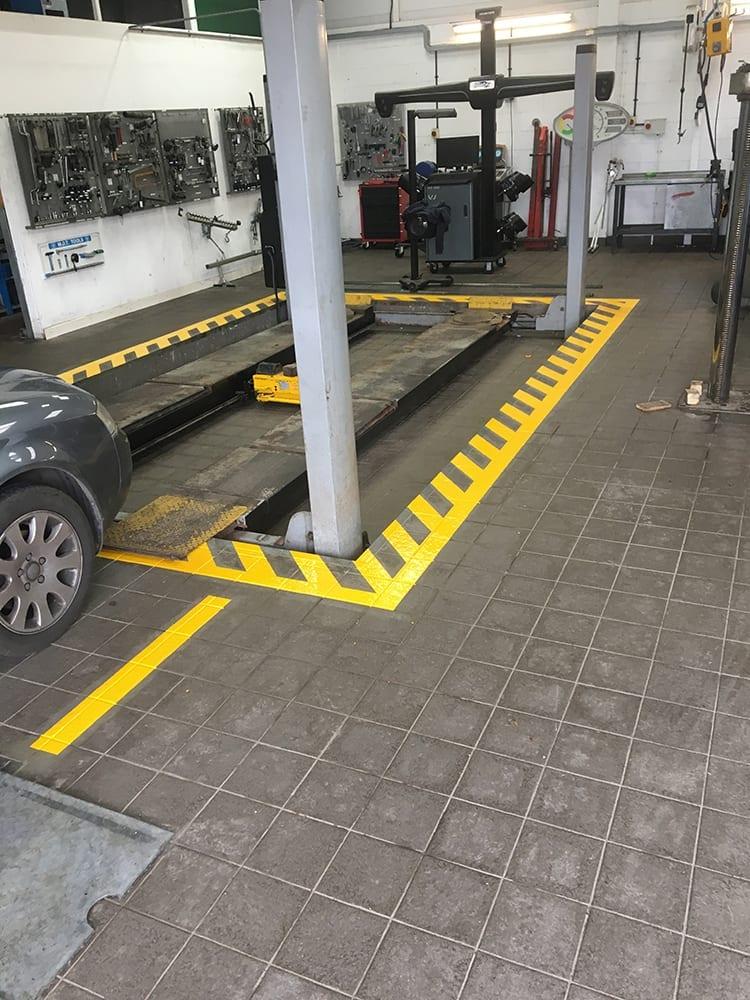 Installing safety lining around a MOT bay