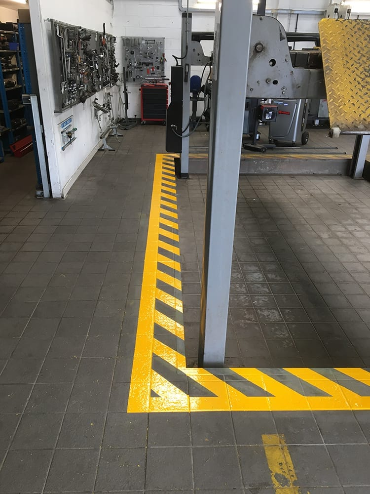 Installing Safety Lining Around A Mot Bay In Hereford