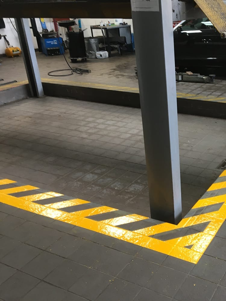Installing safety lining around a MOT bay